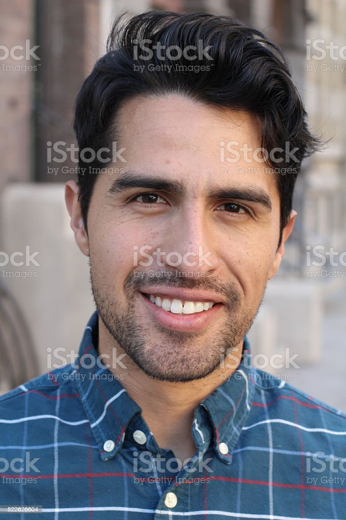 Young man smiling with urban background stock photo