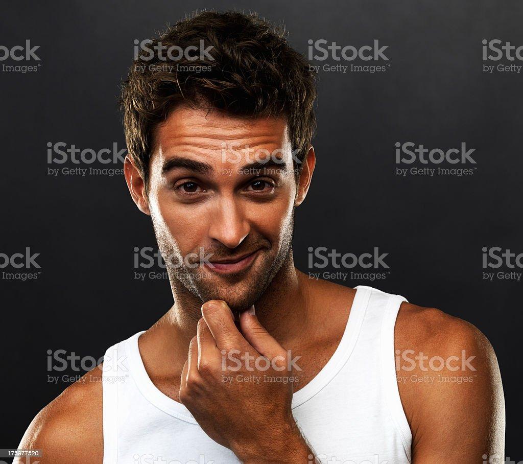 Young man smirking stock photo