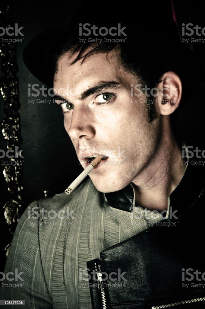 Young Man Smoking Cigarette royalty-free stock photo