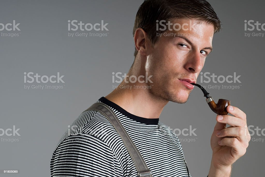 Young man smoking stock photo