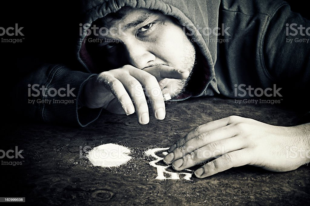 Young Man Snorting Cocaine stock photo