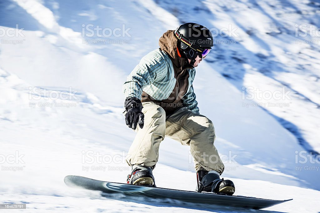 Young man snowboarding royalty-free stock photo