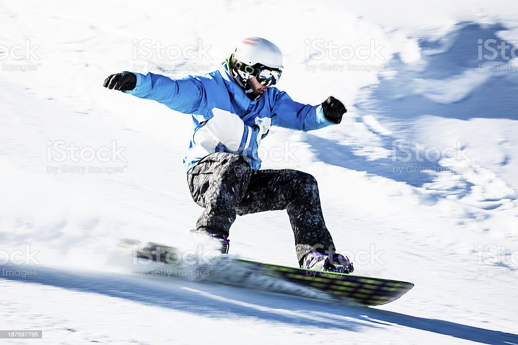 Young man snowboarding stock photo