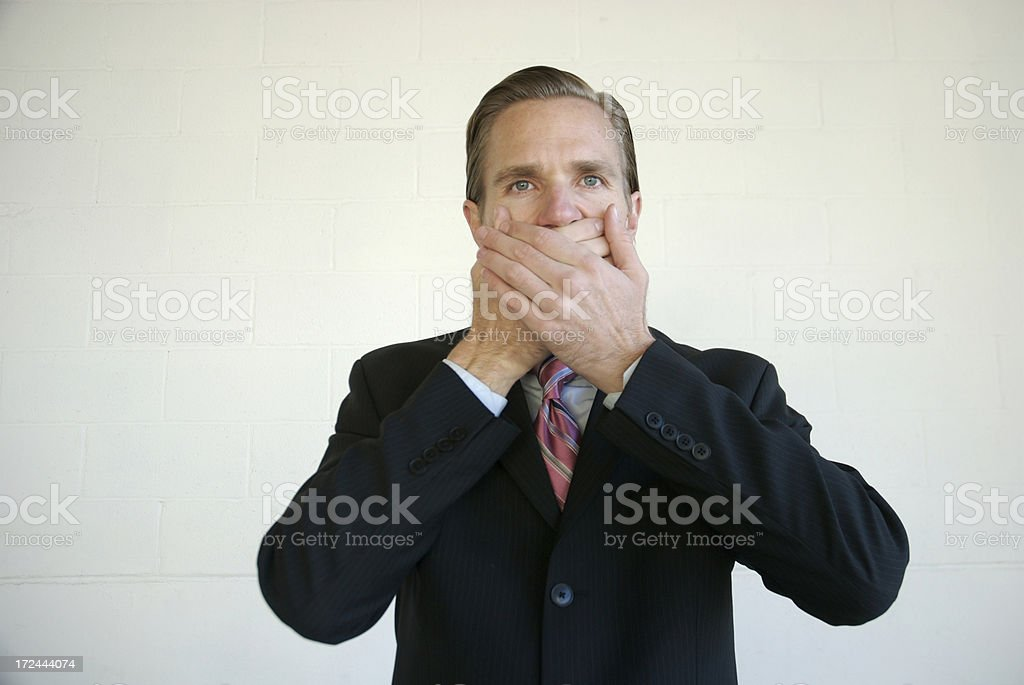 Young Man Speak No Evil Businessman Covering Mouth stock photo