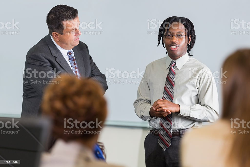Young man speaking during business conference or seminar event stock photo