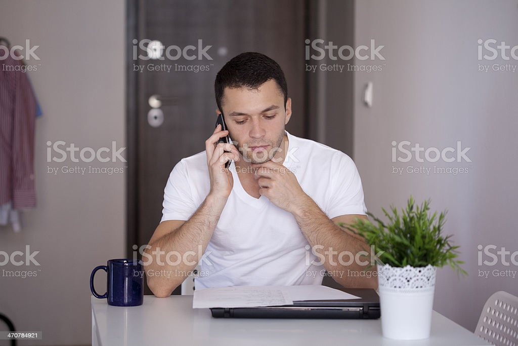 young man speaking on phone royalty-free stock photo