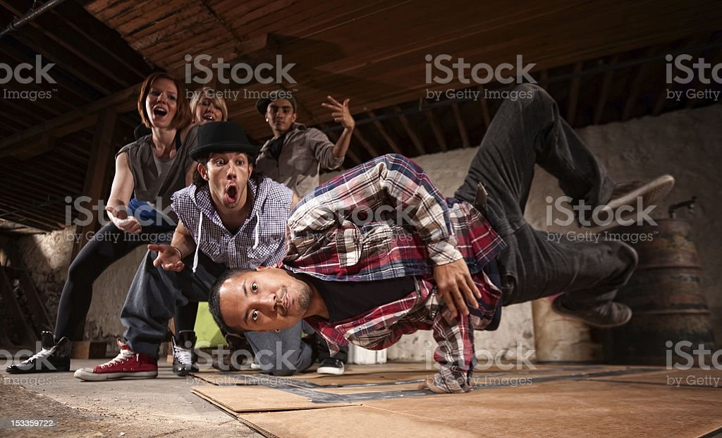 Young Man Spins on His Hand stock photo