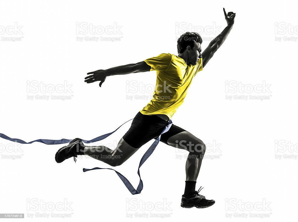 young man sprinter runner running winner finish line silhouette royalty-free stock photo