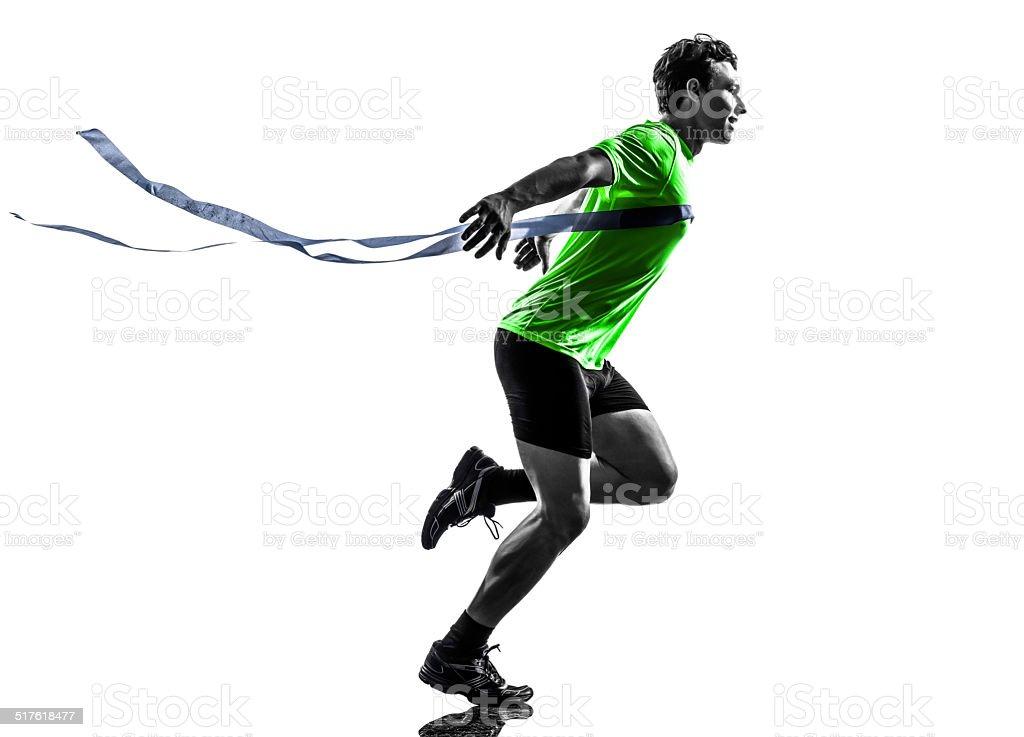 young man sprinter runner running winner finish line silhouette stock photo