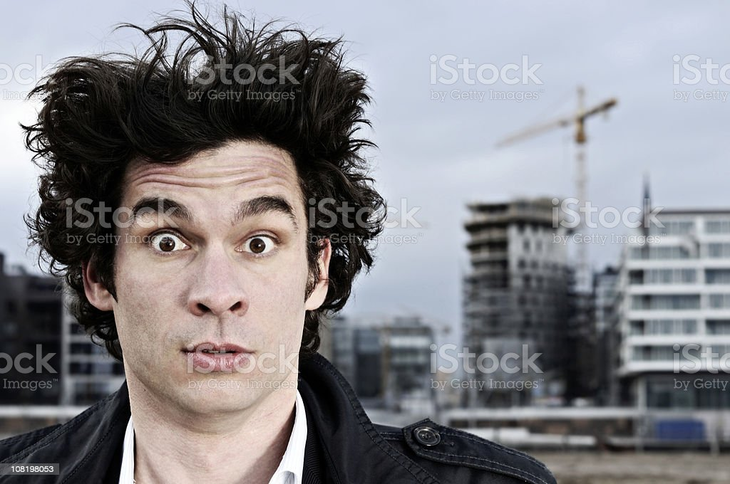 Young Man Standing in Front of Construction Site royalty-free stock photo