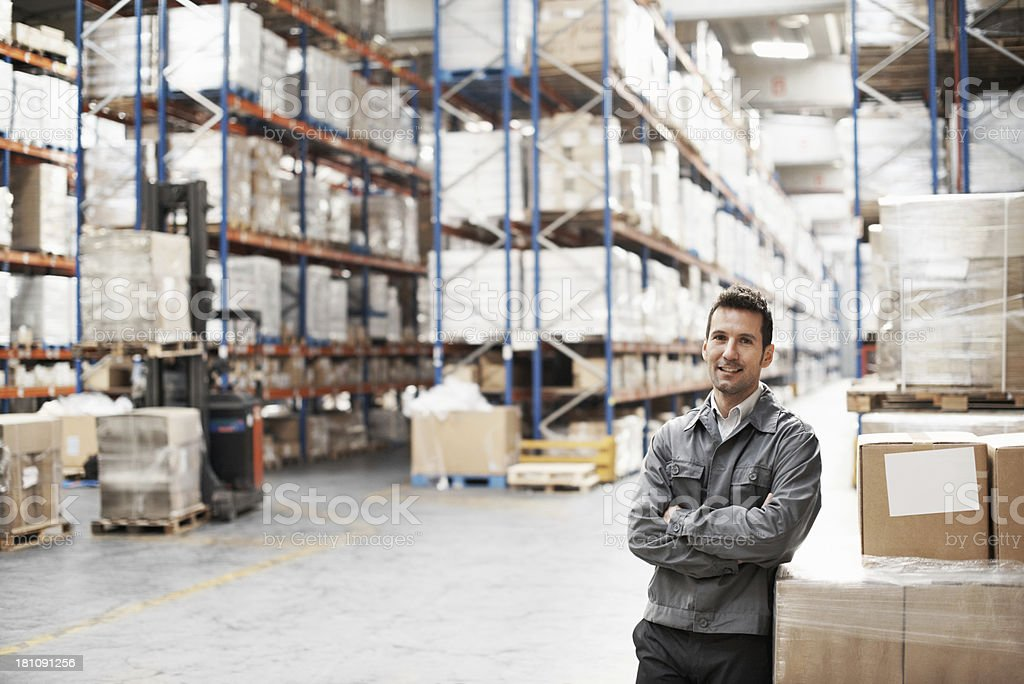 Young man standing in warehouse royalty-free stock photo