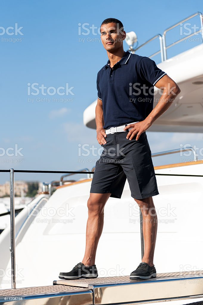 Young man standing on ferry stock photo