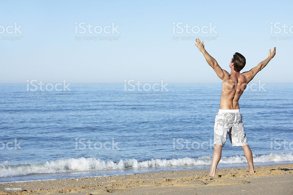 Young Man Standing On Summer Beach royalty-free stock photo