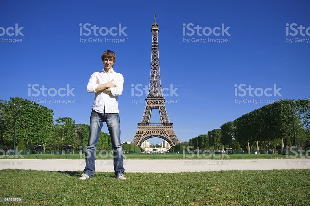 Young man standing on the Champs de Mars royalty-free stock photo