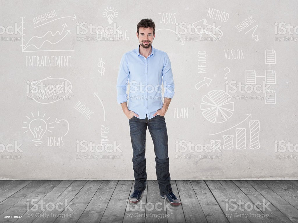 young man standing up in front of financial sketches stock photo