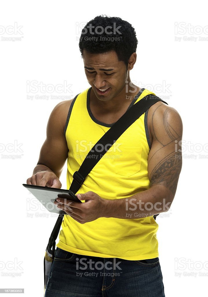 Young man standing with digital tablet royalty-free stock photo