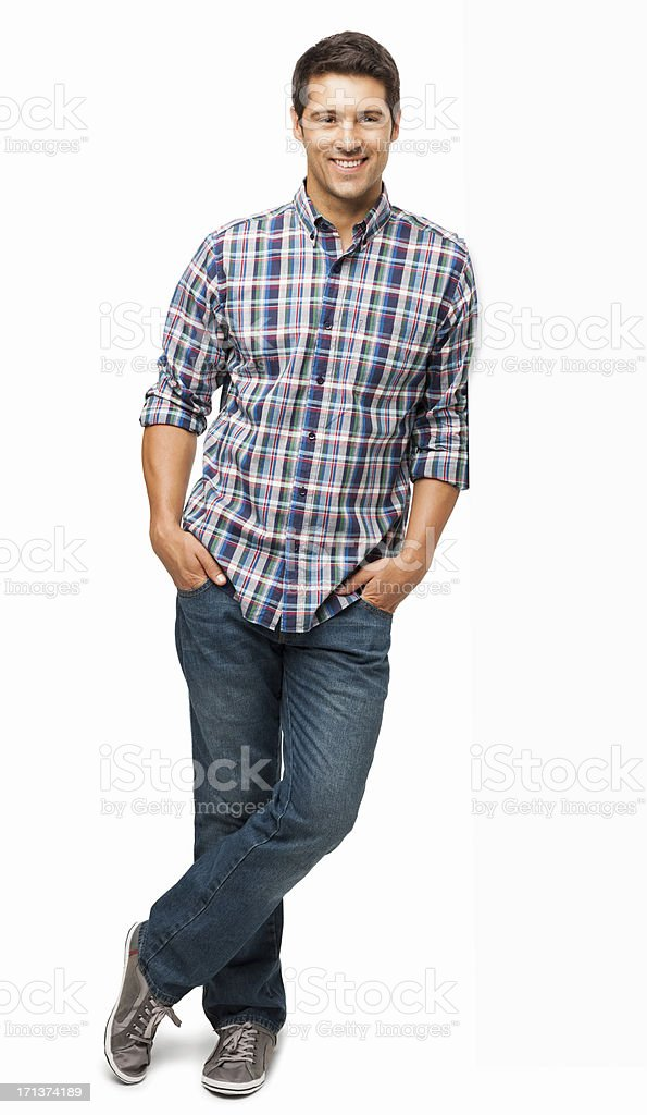 Young Man Standing With Hands In Pockets - Isolated stock photo