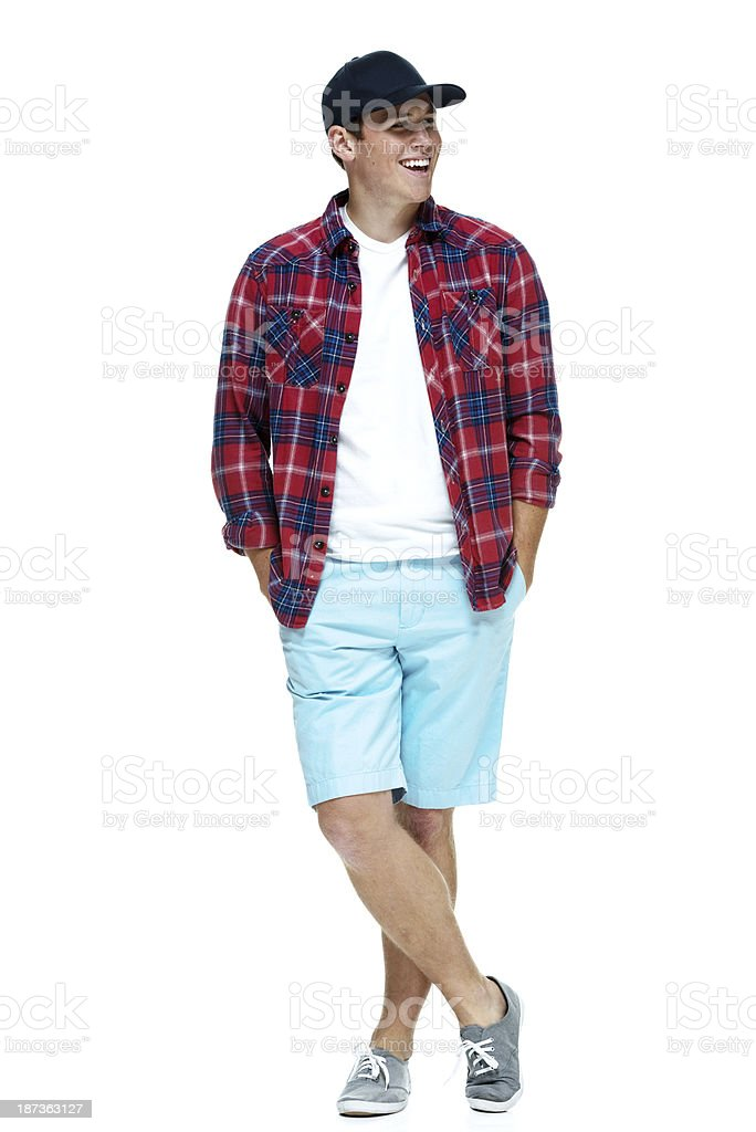 Young man standing with hands in pockets royalty-free stock photo