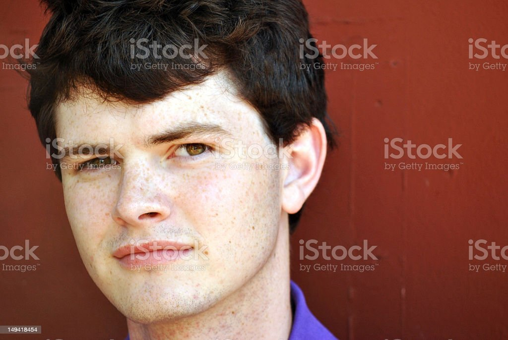 Young man staring stock photo