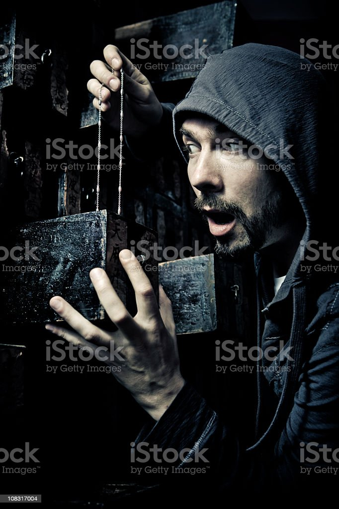 young man stealing a necklace stock photo