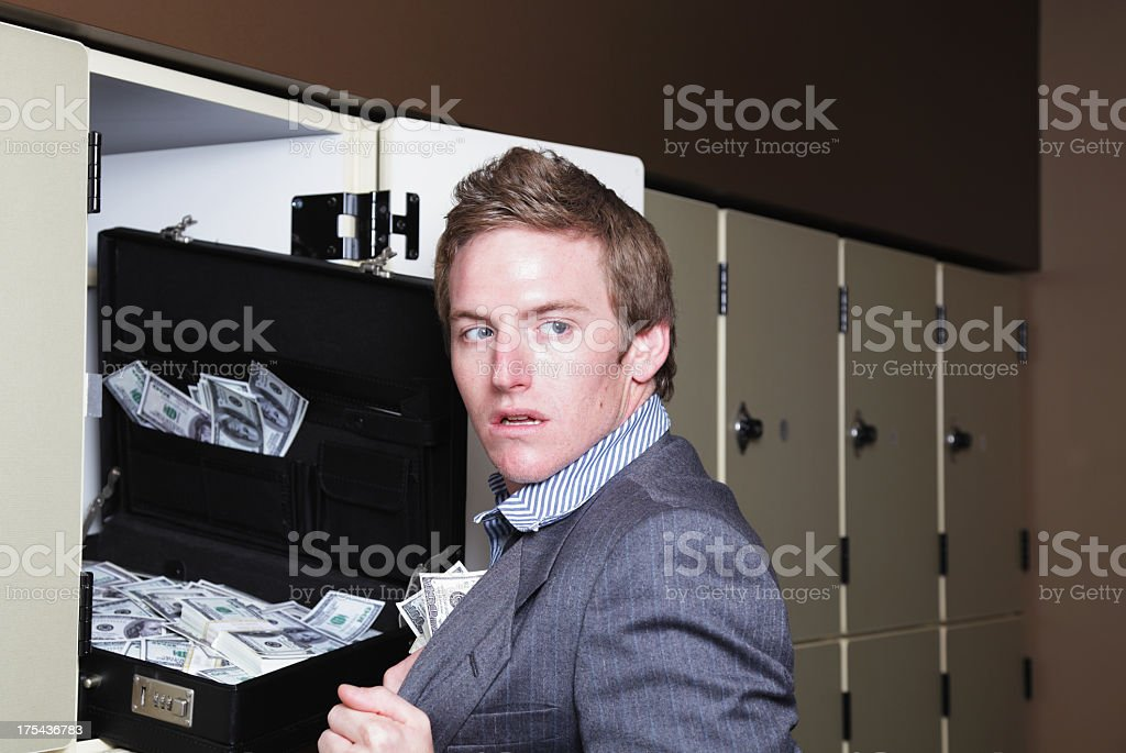 Young Man Stealing Money stock photo