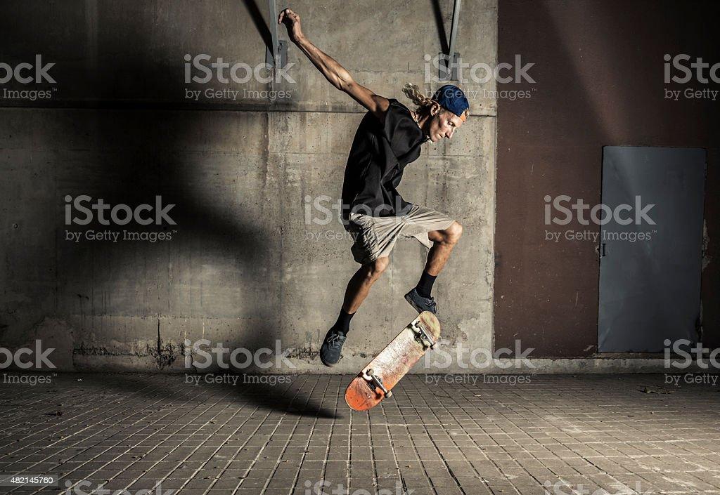Young man street skating stock photo