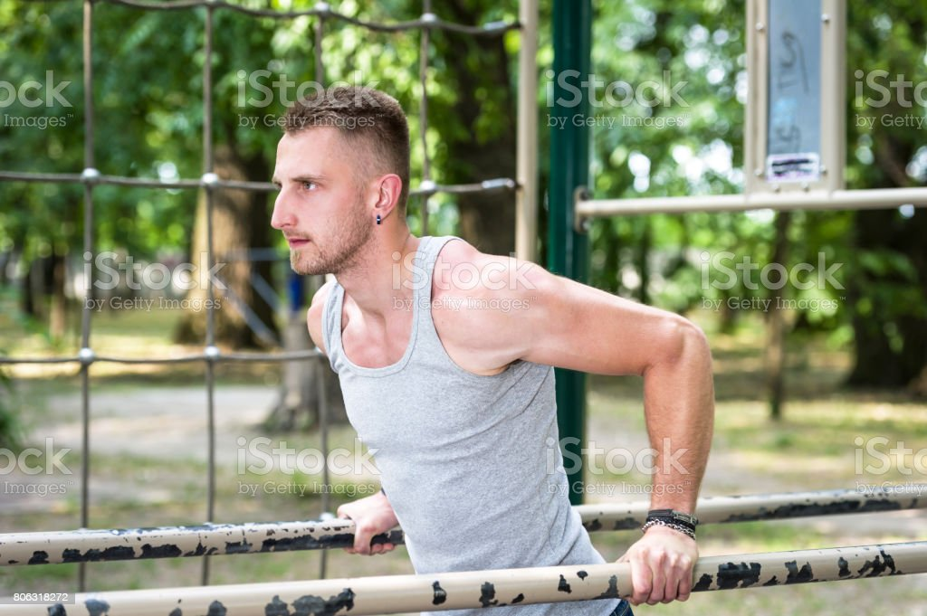 young man street workout training in a park