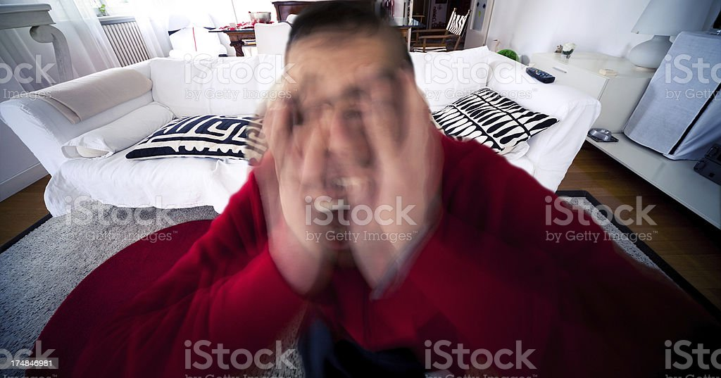 Young man stressed getting crazy at home stock photo