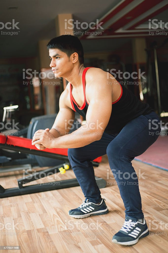 Young man stretching leg stock photo