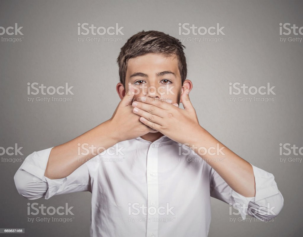 young man, student, boy, covering his mouth with hands stock photo