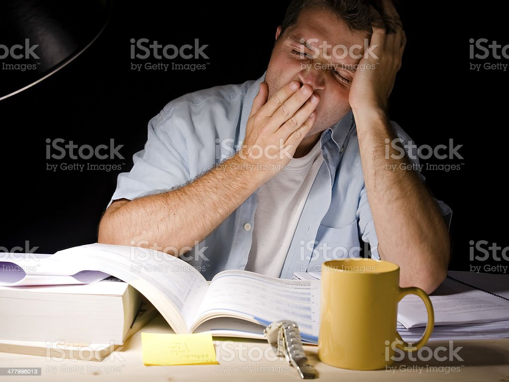 Young Man Studying at Night royalty-free stock photo