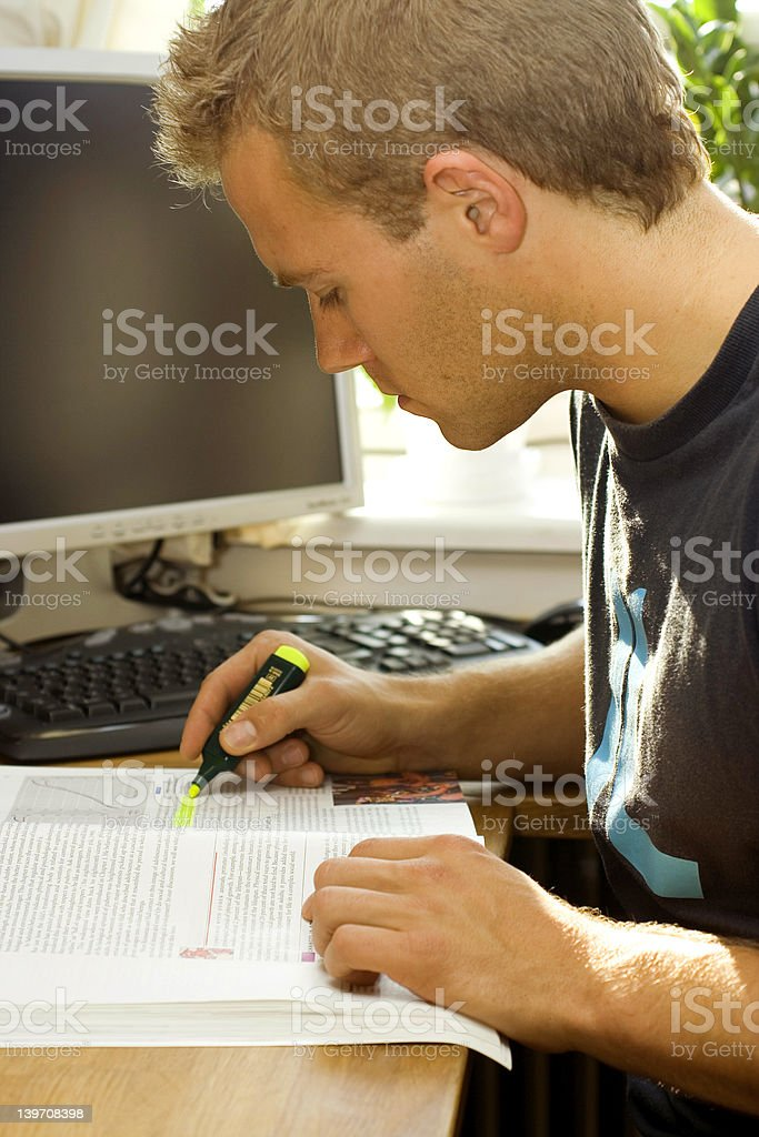 Young man studying in front of his computer royalty-free stock photo