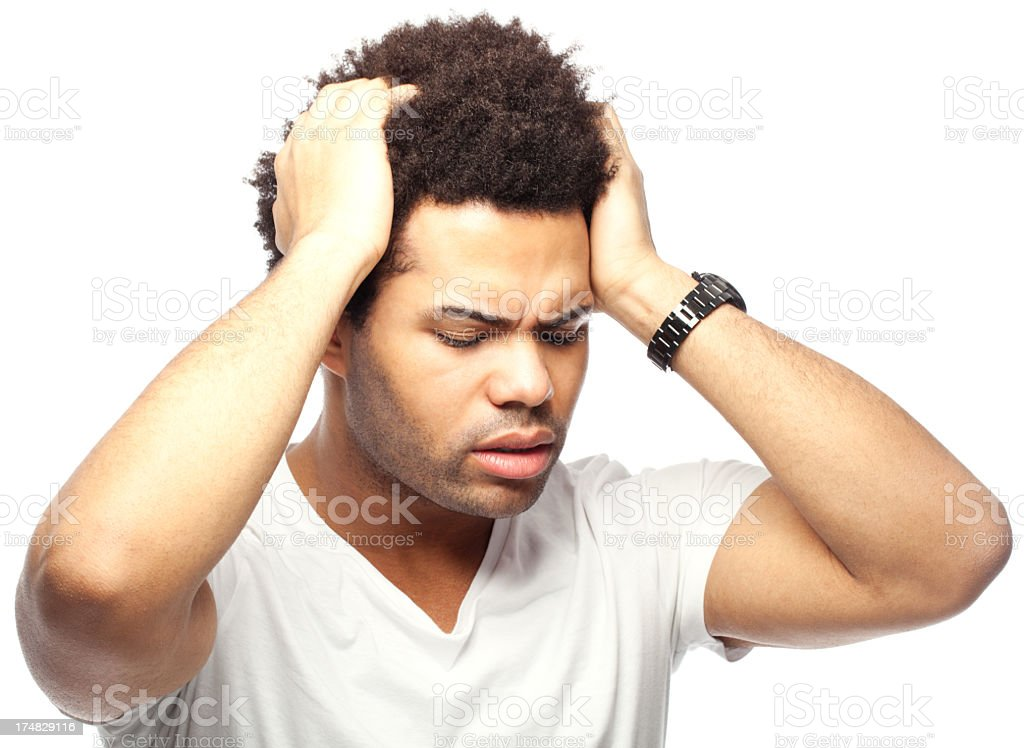 Young man suffering a headache royalty-free stock photo