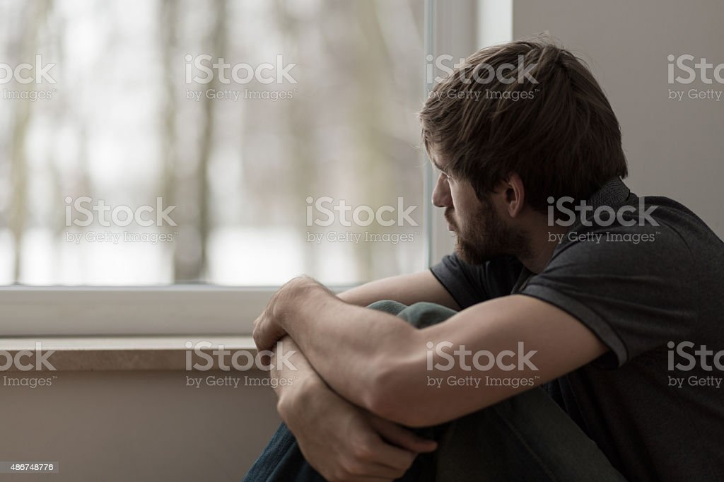 Young man suffering for depression stock photo