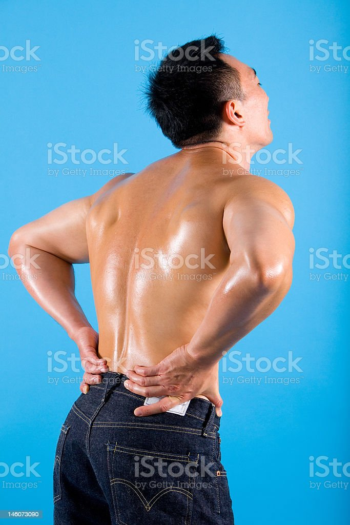 young man suffering from back pain. royalty-free stock photo