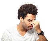 Young man suffering sinusitis
