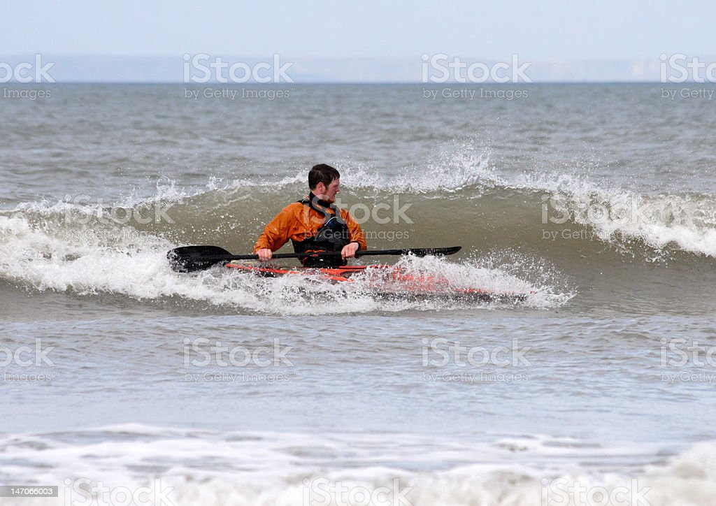 young man surfing in a kayak royalty-free stock photo