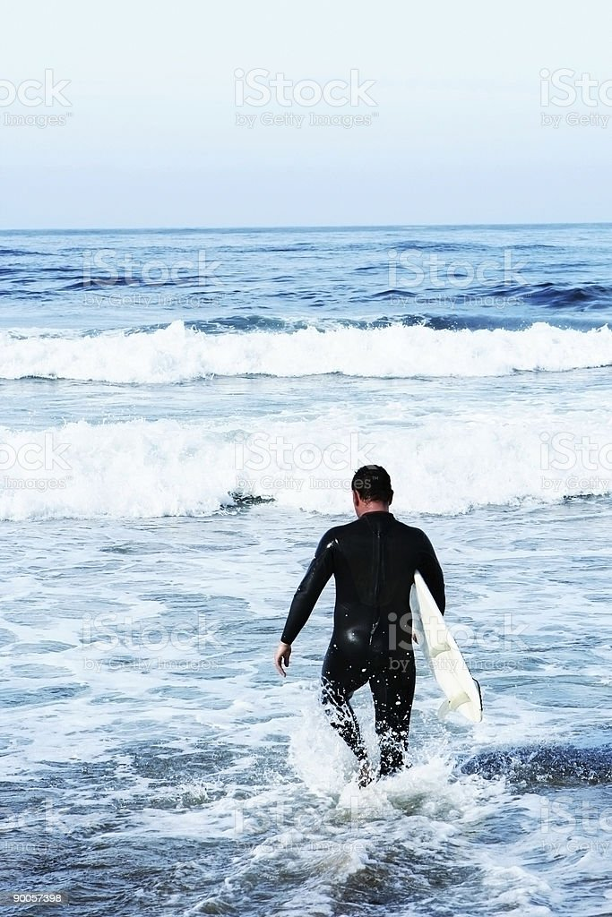 Young Man Surfing stock photo