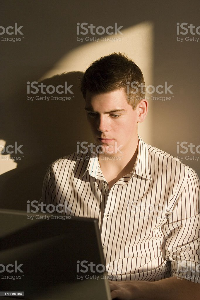 Young man surfing the internet. royalty-free stock photo