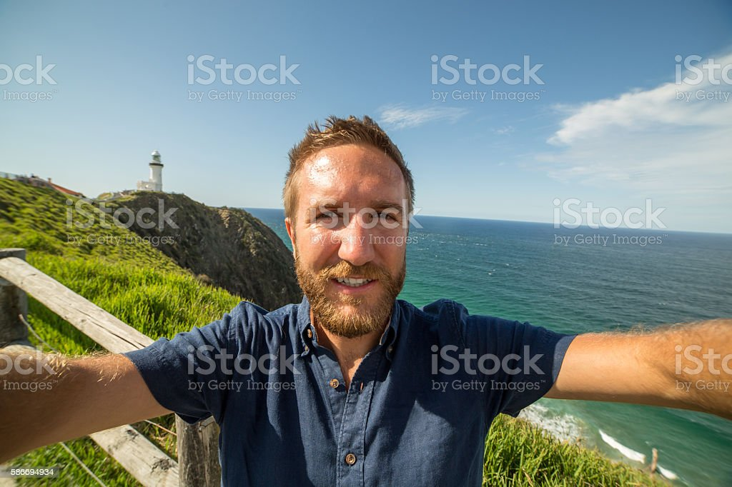 Young man takes a selfie portrait on the east coast stock photo