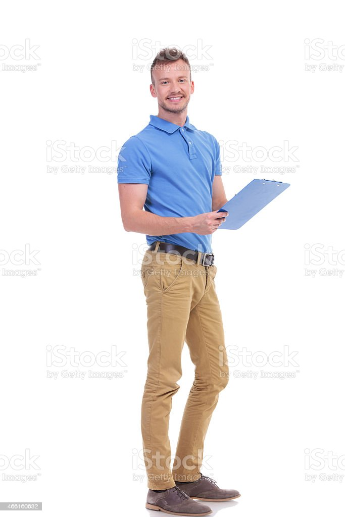young man takes notes on clipboard stock photo