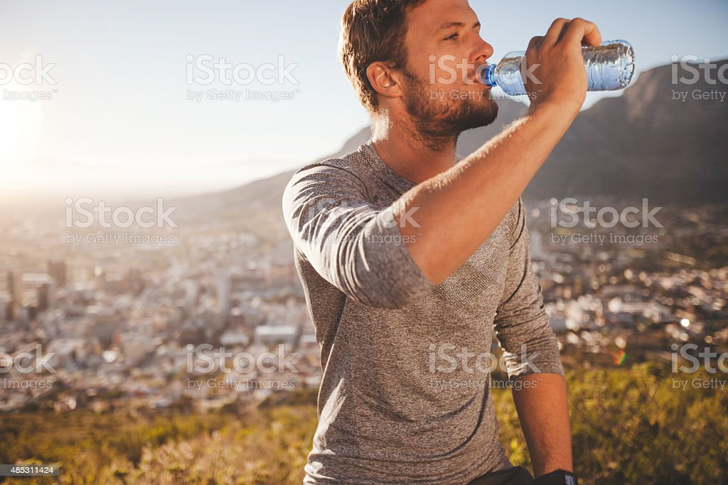 Young man taking a break after morning run stock photo