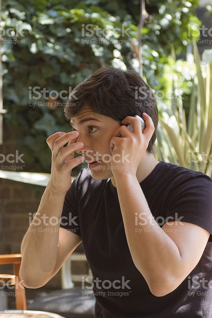 Young man taking a call stock photo