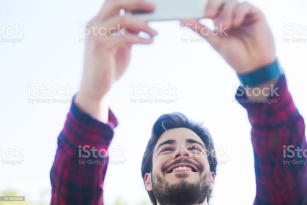 Young man taking a selfie in Barcelona. stock photo