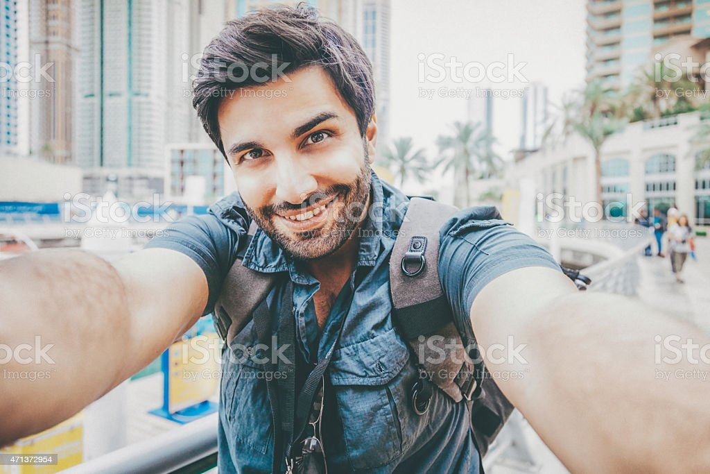 Young man taking a selfie stock photo