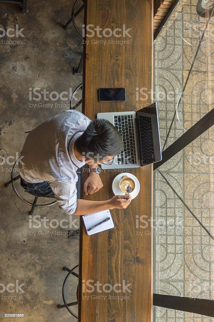 Young man taking break with his coffee to keep awake stock photo