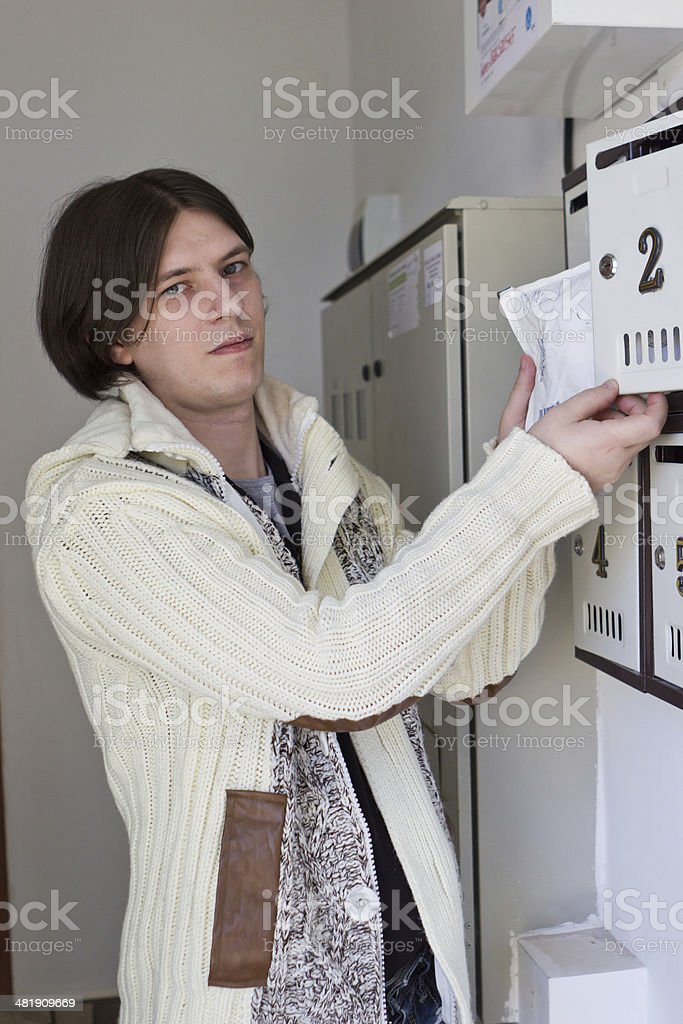 Young man taking mail stock photo