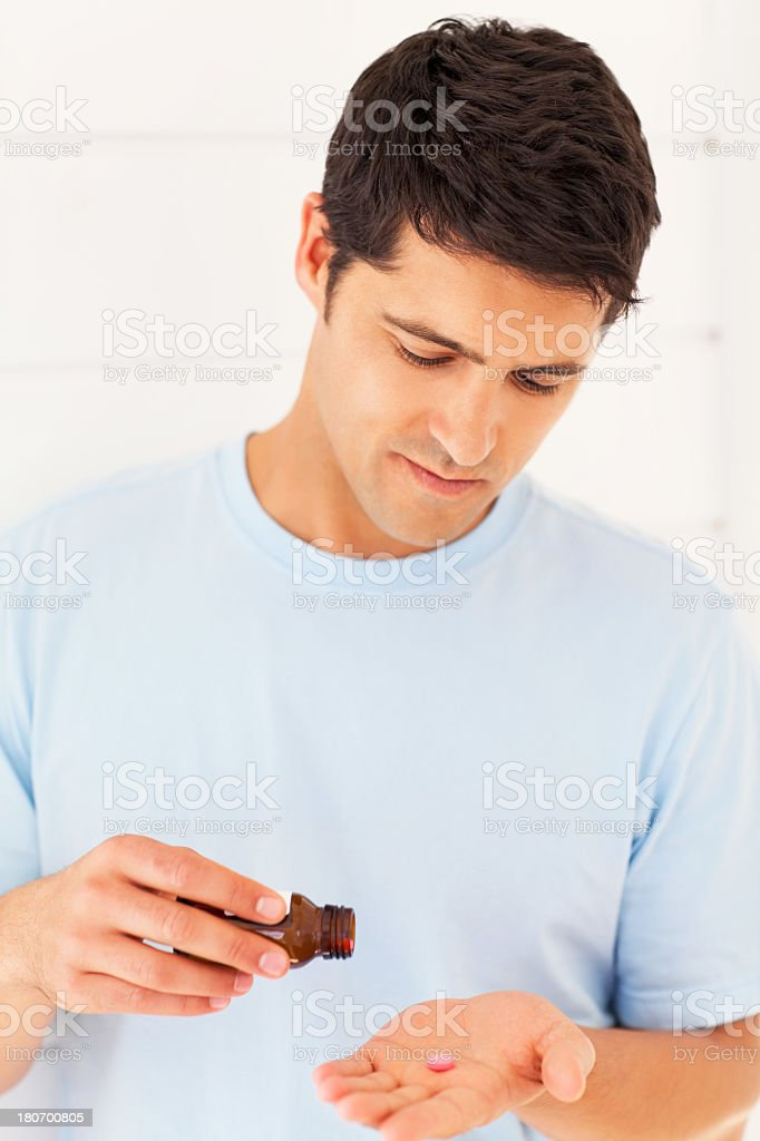 Young Man Taking Medicines royalty-free stock photo