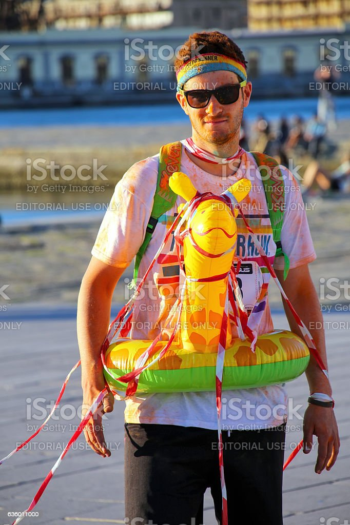 Young man taking part in The Color Run stock photo