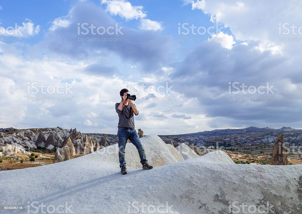 young man taking photo in the wild royalty-free stock photo